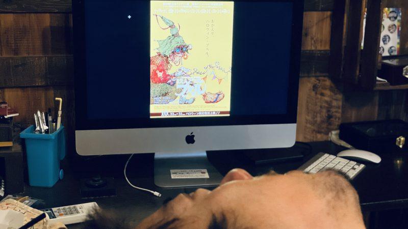 パソコンに写っているえんとつ町のプペルの画像を見ている僕